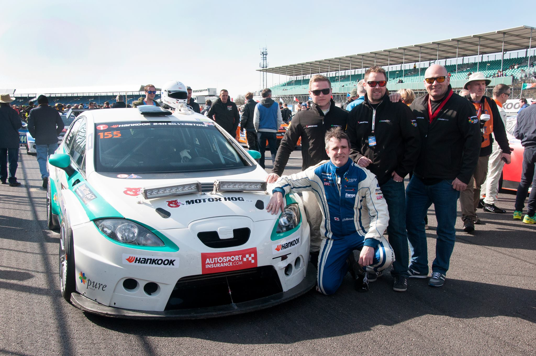 The whole team works together to get the MotorEasy car over the line